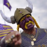 Minnesota Vikings super fan Syd Davy in purple and gold painted face