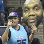 charlotte hornets sports fan holding cardboard head
