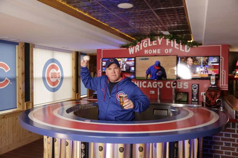 chicago cubs sports fan behind a bar made of baseball bats