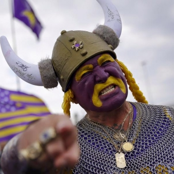 minnesota vikings sports fan face painted with horns hat