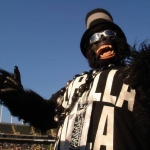 gorilla rilla raider fan in monkey outfit and top hat